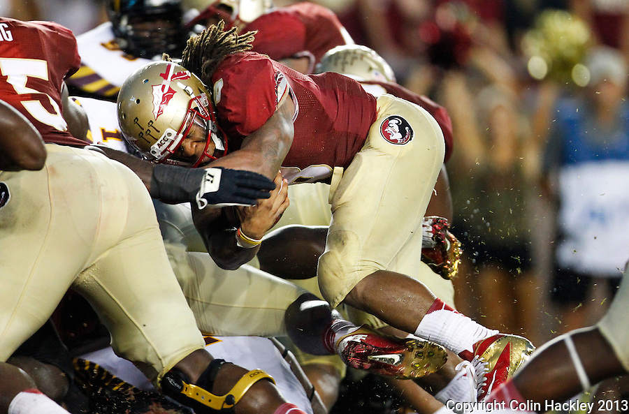 TALLAHASSEE, FLA 9/21/13-FSU-BCC092113CH-Florida State's Devonta Freeman slams into the endzone for a touchdown against Bethune-Cookman during first half action Saturday at Doak Campbell Stadium in Tallahassee. <br /> COLIN HACKLEY PHOTO