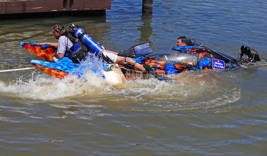 Jul. 18, 2009; Augusta, GA, USA; IHBA rescue personnel bring in the sunken boat of top fuel hydro driver Scotty Lumbert after crashing during qualifying for the Augusta Southern Nationals on the Savannah River. Mandatory Credit: Mark J. Rebilas-