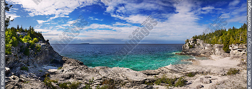 Panoramic scenery of a rocky beach of Georgian Bay, lake Huron at Bruce Peninsula National Park, Ontario, Canada
