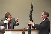 Brendan Shea, a United States Federal Bureau of Investigation (FBI) DNA expert, demonstrating how DNA would be deposited on a the Bushmaster rifle used in the sniper shootings as Prince William County (Virginia) Assistant commonwealth attorney James Willett holds the weapon during his testimony in the trial of sniper suspect John Allen Muhammad in courtroom 10 at the Virginia Beach Circuit Court in Virginia Beach, Virginia, Wednesday, November 5, 2003. <br /> Credit: Dave Ellis - Pool via CNP