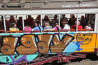 Tram covered in graffiti on a street in the old town of Lisbon, Portugal. Picture by Manuel Cohen