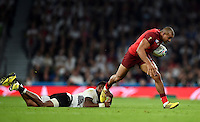 Jonathan Joseph of England takes on the Fiji defence. Rugby World Cup Pool A match between England and Fiji on September 18, 2015 at Twickenham Stadium in London, England. Photo by: Patrick Khachfe / Onside Images