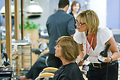 Instructor working on a client in the Arena Salon, Hair & Beauty Dept., Kingston College. , Hair & Beauty Dept., Kingston College.