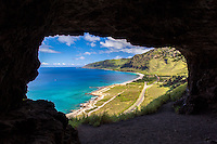 An aerial view of West O'ahu from the inside of Upper Makua Cave, Wai'anae.