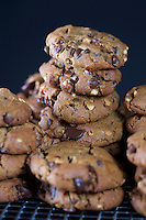 Peanut Butter Chocolate Chip Cookies Stacked on Wire Rack
