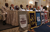 Coaches and hosts at the head table at listen to Don Shea at the 9th annual Bill Dooley Pigskin Preview. Photo by Al Drago.