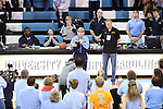 05 January 2014: UNC head coach Sylvia Hatchell (center) talks to cancer survivors at halftime. The University of North Carolina Tar Heels played the University of Maryland Terrapins in an NCAA Division I women's basketball game at Carmichael Arena in Chapel Hill, North Carolina. Maryland won the game 79-70.