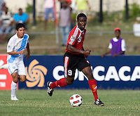 Shackiel Henry (9) of Trinidad & Tobago moves upfield  during the group stage of the CONCACAF Men's Under 17 Championship at Jarrett Park in Montego Bay, Jamaica. Trinidad & Tobago defeated Guatemala, 1-0.