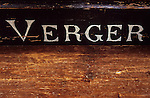 Antique sign in handpainted Georgian lettering on bench or church pew stating Verger