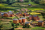Mud brick and thatch roof homes on the outskirts of the village of Sandrandahy, in the central highlands of Madagascar.