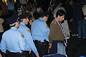 Man is arrested at Uptown parade, 2004