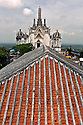 TH00362-00...THAILAND - View over a tile roof on the west peak of Khoa Wang, location of one of the palaces of Rama IV, (King Mongkut), named the Phra Nakhon Khiri Palace at Phetchaburi.