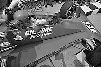 INDIANAPOLIS, IN: AJ Foyt guides his Coyote 75/Foyt TC into victory lane after he becomes the first four-time winner of the Indianapolis 500 on May 29, 1977.