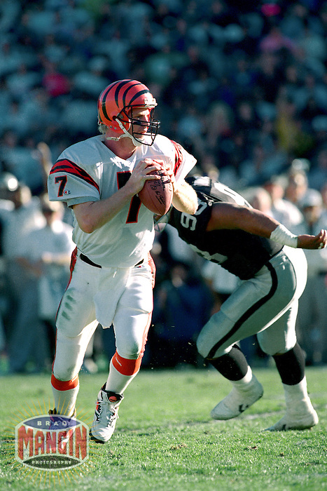 LOS ANGELES, CA - Quarterback Boomer Esiason of the Cincinnati Bengals in action during the AFC Playoff Game against the Los Angeles Raiders at the Los Angeles Memorial Coliseum in Los Angeles, California on January 13, 1991. Photo by Brad Mangin.