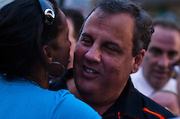 New Jersey Governor Chris Christie (C ) salutes residents while he attends the National Night Out festivities in Union City, New Jersey, Aug 6, 2013. Photo by Eduardo Munoz Alvarez / VIEWpress.