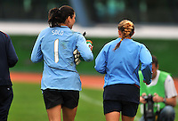 Hope Solo (L) and Rachel Buehler (R) take a cool down jog post-game. The USWNT defeated Iceland (2-0) at Vila Real Sto. Antonio in their opener of the 2010 Algarve Cup on February 24, 2010.