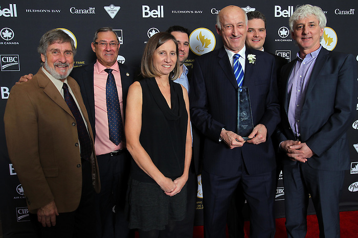 Ottawa, ON – Nov 27 2015 –Donald Royer and friends pose for a photo at the Canadian Paralympic Hall of Fame in Ottawa, Ontario Nov 27, 2015. Royer was inducted into the Hall of Fame in the builder category. Photo Andre Forget / Canadian Paralympic Committee