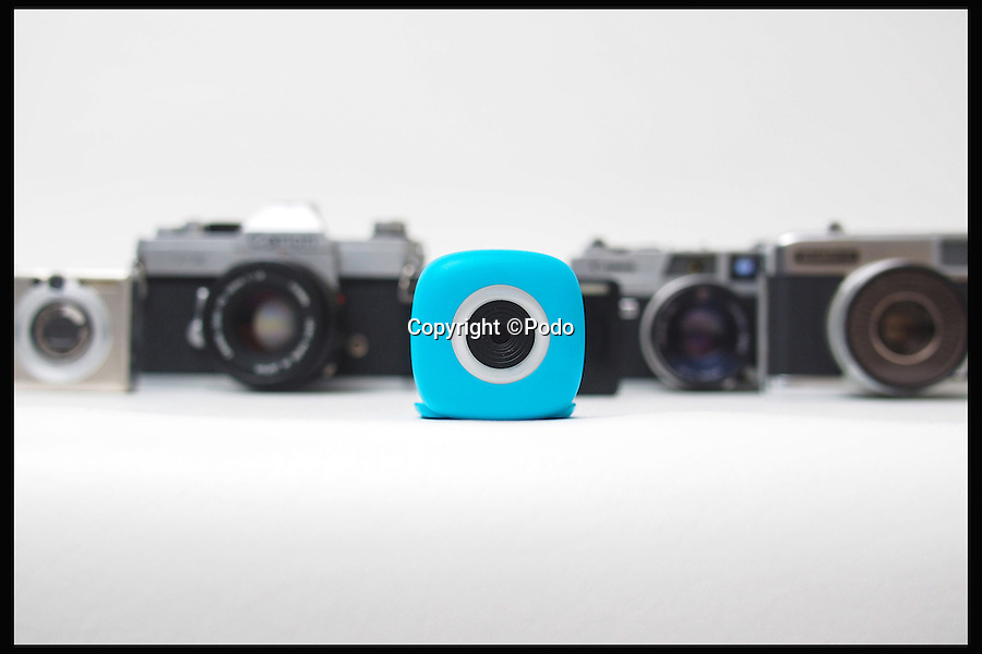 BNPS.co.uk (01202 558833)<br /> Pic: Podo/BNPS<br /> <br /> *Please use full byline*<br /> <br /> The Podo, against other cameras.<br /> <br /> The selfie stick could soon be a thing of the past thanks to this tiny camera you can stick anywhere then send the photos back to your phone. <br /> <br /> The nifty gadget boasts a tiny suction pad that can attach itself to any surface - and it can then be controlled by a smartphone using Bluetooth.<br /> <br /> It means users can take photos of themselves without the need for or constraints of a selfie stick, then upload the picture to the internet via their phones.<br /> <br /> The device, called a Podo, has just launched on crowdfunding website Kickstarter, and can be bought for $89 - around &pound;60.