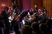 """Blues legend B.B. King performs with an all-star cast at a White House event titled In Performance at the White House: Red, White and Blues, February 21, 2012 in Washington, DC.  As part of the In Perfomance series, music legends and contemporary major artists have been invited to perform at  the White House for a celebration of Blues music and in recognition of Black History Month. The program featured performances by Troy """"Trombone Shorty"""" Andrews, Jeff Beck, Gary Clark, Jr., Shemekia Copeland, Buddy Guy, Warren Haynes, Mick Jagger, Keb Mo, Susan Tedeschi and Derek Trucks, with Taraji P. Henson as the program host and Booker T. Jones as music director and band leader. .Credit: Win McNamee / Pool via CNP"""