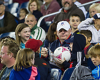 A new England fan with a ball that missed a shot at the Houston goal.  The New England Revolution played to a 1-1 draw against the Houston Dynamo during a Major League Soccer (MLS) match at Gillette Stadium in Foxborough, MA on September 28, 2013.