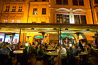 Czeck Republic, Prague, Busy outdoor cafe in old town square.
