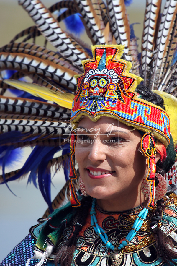 An Incan South American Indian in a fancy feather headdress at the Milwaukee Lakefront Indian Summer Festival, Wisconsin