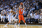 26 January 2015: Syracuse's Trevor Cooney (10) shoots over North Carolina's J.P. Tokoto (left). The University of North Carolina Tar Heels played the Syracuse University Orange in an NCAA Division I Men's basketball game at the Dean E. Smith Center in Chapel Hill, North Carolina. UNC won the game 93-83.
