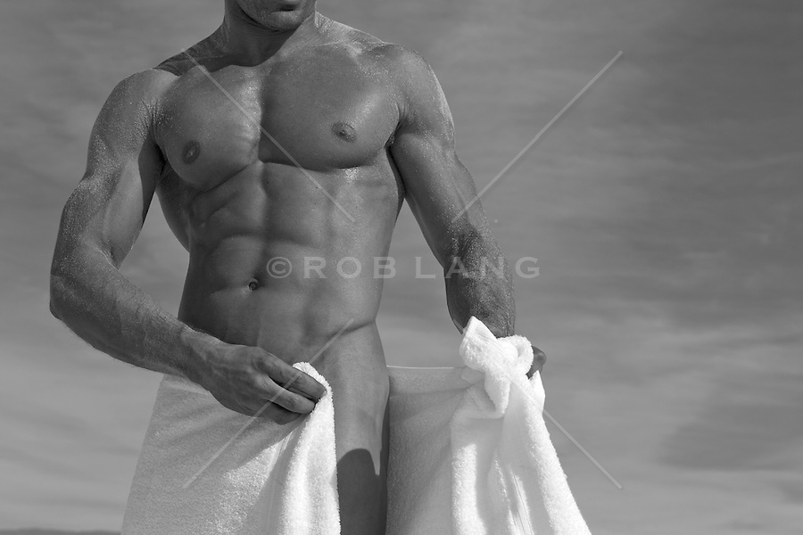 naked man with a great body wrapping a towel around his waist