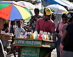 "Selling shaved ice, a man navigates his cart through the largest ""tent city"" of Haitian earthquake survivors, located on a former nine-hole golf course in Port-au-Prince. The Petionville Club is host to more than 44,000 people.."