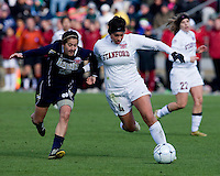 Alina Garciamendez (4) of Stanford fights for the ball with Rose Augustin (15) of Notre Dame during the final of the NCAA Women's College Cup at WakeMed Soccer Park in Cary, NC.  Notre Dame defeated Stanford, 1-0.