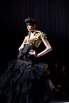 CAPE TOWN, SOUTH AFRICA - AUGUST 13: Tatum Keshwar, a model, and Miss South Africa in 2009,  walks on the catwalk with one outfit from Stoned Cherrie, a fashion label, at the African Fashion International Cape Town fashion week on August 13, 2010, at the Cape Town International Convention Center, in Cape Town, South Africa. Stoned Cherrie is founded by Nkhensani Nkosi, age 37, a mother of four and a celebrated fashion designer, entrepreneur, television personality and an actress in South Africa. She launched her new collection Love Movement at this event. (Photo by Per-Anders Pettersson)