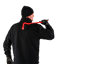 caucasian burglar with a crowbar in his hand