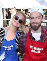 Los Angeles, CA - NOVEMBER 23: Jennifer Åkerman, Tom Payne, At Los Angeles Mission Thanksgiving Meal For The Homeless At Los Angeles Mission, California on November 23, 2016. Credit: Faye Sadou/MediaPunch