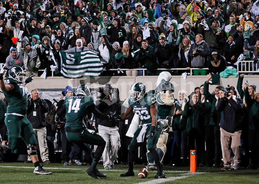 Michigan State Spartans running back Jeremy Langford (33) and wide receiver Tony Lippett (14) celebrate Langford's touchdown run during the first quarter of the NCAA football game at Spartan Stadium in East Lansing, Michigan on Nov. 8, 2014. (Adam Cairns / The Columbus Dispatch)