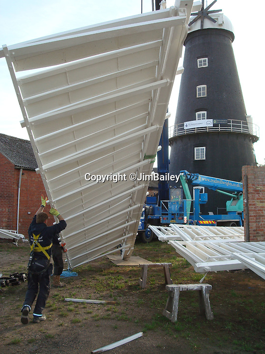 BNPS.co.uk (01202 558833)<br /> Pic: JimBailey/BNPS<br /> <br /> The 1 ton sails is hoisted into place.<br /> <br /> Octo-mill turns again...'Ferrari of windmills' is restored.<br /> <br /> Britains only eight sailed windmill is working once again after a &pound;150,000 restoration to repair its unique sails.<br /> <br /> Heckington Mill has ground wheat to make flour since 1830 but it was closed down when two of its enormous wooden sails were found to have rotted. <br /> <br /> Four years and more than 100,000 pounds were spent crafting the one-tonne, 34ft sails from the trunks of Siberian larch trees so that the historic mill near Boston, Lincs, could continue to operate.<br /> <br /> And after a nail-biting operation to crane the old sails off and replace them with the new ones, the Grade I-listed building has been brought back to life.<br /> <br /> Eight-sailed mills were at the forefront of milling technology and experts have described Heckington Mill as &quot;the Ferrari of windmills&quot;.<br /> <br /> Miller Jim Bailey, 62, hopes that with the help of the mill's new sails he can increase output to five tonnes of flour a year within the next three years.