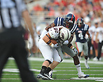 Southern Illinois' C.J. Robertson (82) is tackled by Ole Miss' Aaron Garbutt(20) at Vaught-Hemingway Stadium in Oxford, Miss. on Saturday, September 10, 2011. Ole Miss won 42-24.