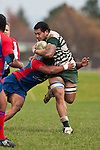 Roger Hasiata tries to fend off Risiate Tadulala's tackle. Counties Manukau Premier Club Rugby game between Manurewa and Ardmore Marist played at Mountfort Park, Manurewa on Saturday June 19th 2010..Manurewa won the game 27 - 10 after leading 15 - 5 at halftime.