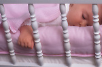 Baby girl in crib sleeping