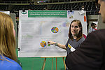 Courtney Donker, a first year graduate student, presents her project on how to use traditional Native American customs to help the climate and land during the Student Expo on April 14, 2016. Donker said she has been working on the project since November and plans to continue her research. Photo by Emily Matthews
