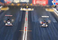 Feb 28, 2016; Chandler, AZ, USA; NHRA top fuel driver Steve Torrence (left) races alongside Terry McMillen during the Carquest Nationals at Wild Horse Pass Motorsports Park. Mandatory Credit: Mark J. Rebilas-