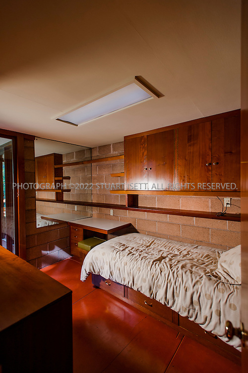 """10/9/2012--Sammamish, WA, USA..VIEW: Interior showing one of the childrens' rooms..Architect Frank Lloyd Wright planned his """"Usonian"""" homes to be affordable for middle-class families. The 1,9500 square foot Brandes home is for sale in Sammamish, Washington (30 minutes from Seattle) at $1.39 million. It features three bedrooms, two bathrooms and a small, separate office/study space...The home was built in 1952, and has redwood trim and Wright's original furniture and some garden sculptures by Wright. It's one of only three Frank Lloyd Wright homes near Seattle...©2012 Stuart Isett. All rights reserved."""