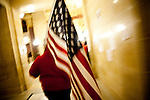 Special-ed teacher Felicia Pendleton carries an American flag during a protest against a bill to eliminate collective bargaining at the State Capitol in Madison, Wisconsin, February 24, 2011.