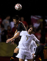 Alex Crognale (2) of Maryland goes up for a header against Chris Davis (7) of Pittsburgh during the game at Ludwig Field on the campus of the University of Maryland in College Park, MD.  Maryland defeated Pittsburgh, 2-0.