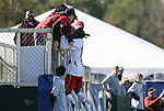 16 November 2008: Maryland's Jeremy Hall (in white) jumps up to some fans after scoring a goal. The University of Maryland defeated the University of Virginia 1-0 at WakeMed Stadium at WakeMed Soccer Park in Cary, NC in the men's ACC tournament final.