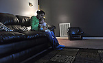 Mimi Ocampo holds her youngest child, Meli, to give her a breathing treatment in her apartment in London, Ky., on the morning of Thursday, Oct. 25, 2012. Meli, who is 14 months old, has allergies and needs the steam treatment many mornings, Ocampo said. Meli was born at 33 weeks and spent 23 days in the hospital in Lexington, Ky., before Ocampo could bring her home. Ocampo visited her daughter everyday she was in the hospital.   Photo by Taylor Moak