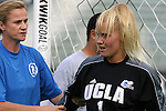 1 December 2006: UCLA's Valerie Henderson (1) is tended to by UCLA head coach Jillian Ellis (l) after stopping a hard shot with her face during pregrame warmups. The University of North Carolina Tarheels defeated the University of California Los Angeles Bruins 2-0 at SAS Stadium in Cary, North Carolina in an NCAA Division I Women's College Cup semifinal game.