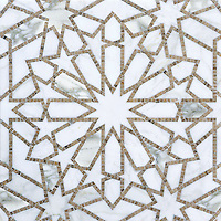 Castilla, a natural stone waterjet and hand cut mosaic shown in Jura Grey honed and Calacatta Tia polished, is part of the Miraflores Collection by Paul Schatz for New Ravenna Mosaics.<br />