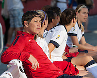 USWNT forward Abby Wambach (20) was on the bench for the first half of the international friendly, the US Women's National Team (USWNT) (white/blue) beat Korea Republic (South Korea)  (red/blue) 4-1, at Gillette's Stadium on June 15, 2013.