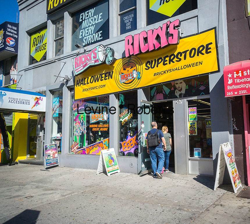 A Ricky's Superstore decorated for Halloween in New York entices shoppers with the Halloween supplies available inside, seen on Wednesday, October 19, 2016. The National Retail Federation reports over 171 million Americans will celebrate Halloween spending an average of $82.93 on accoutrements with total spending reaching $8.4 billion. (© Richard B. Levine)