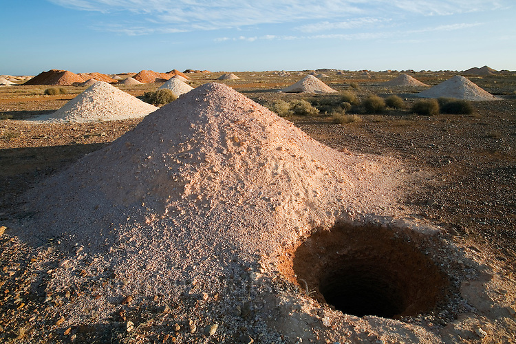 Drilled mine shaft in the Coober Pedy opal fields.  Coober Pedy, South Australia, AUSTRALIA.